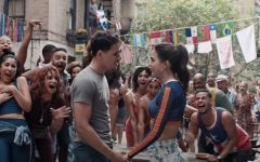 The character Usnavi, played by actor Anthony Ramos, is seen holding hands with the character Vanessa, played by actress Melissa Barrera.
